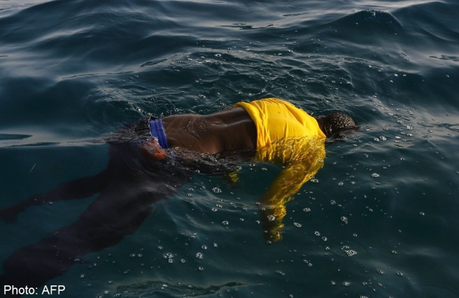 This is what a drowned person looks like. Never forget. Humanity. AFP PHOTO/MAHMUD TURKIA