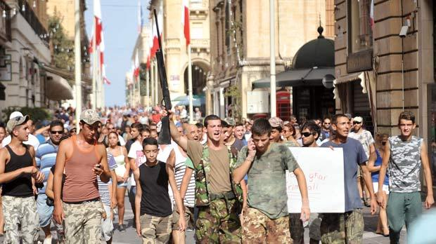 The real McCoy, parading down the main street of Malta's capital city, Valletta